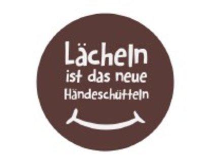 raps_schokoaufleger_%2522laecheln_ist_das_neue_haendeschuetteln%2522